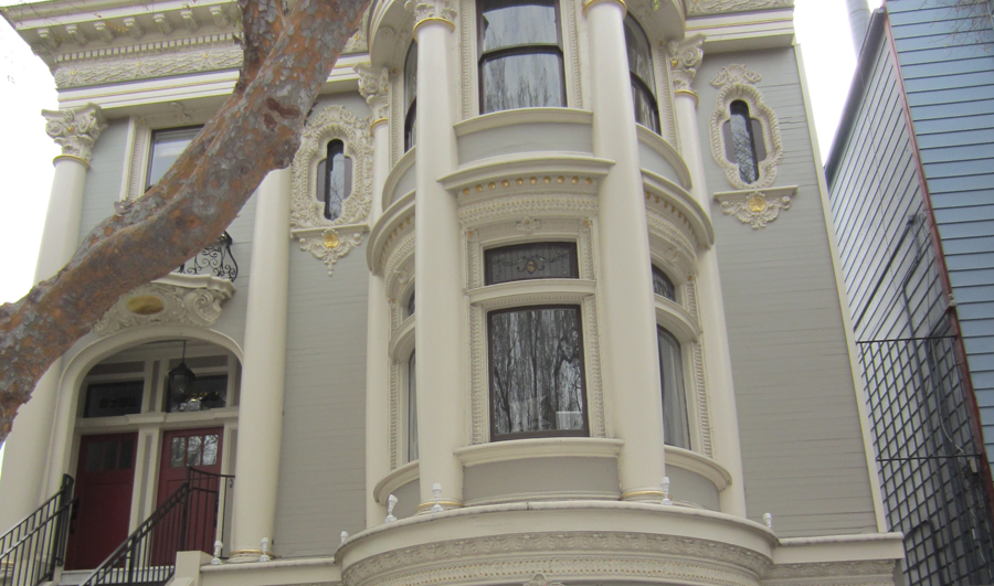 detailed view of front of house showing curved bay windows